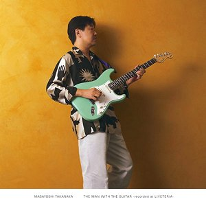 Image for 'The Man With The Guitar'
