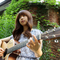 juniel and panini (the guitar) by a vine-rambled cottage