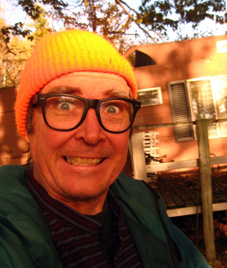 Wearing safety orange hat in front of the haunted trailer