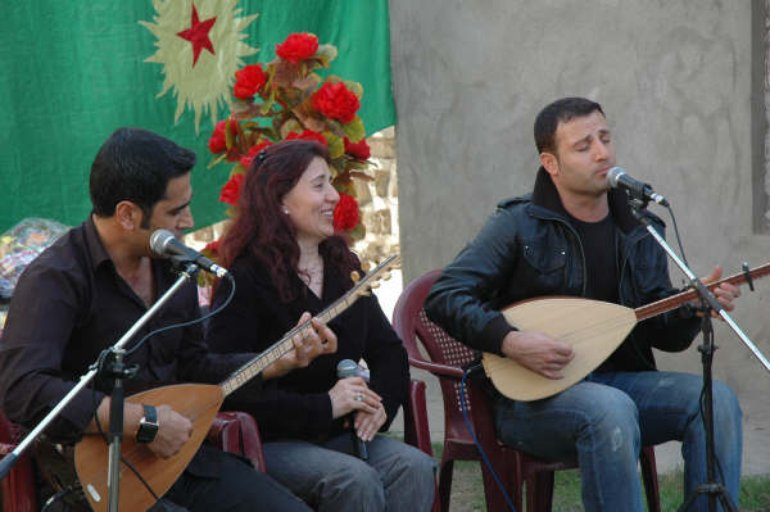 Diyar with Beser Şahîn & Delîl Dîlanar at the PCDK anniversary in Southern Kurdistan
