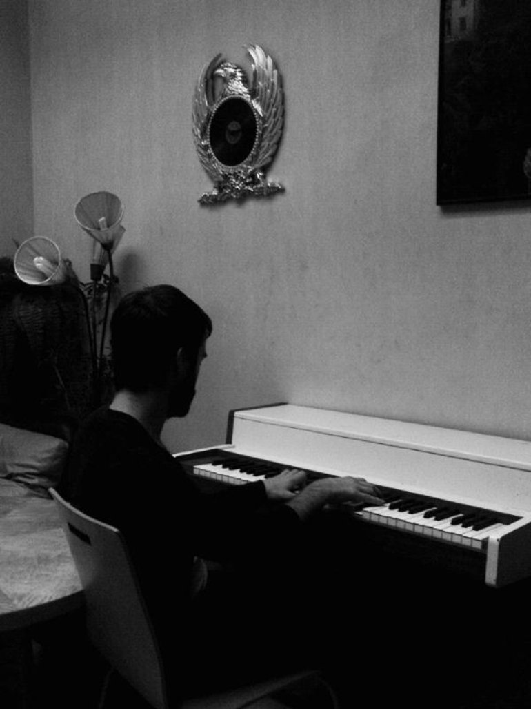 Danny figuring out some piano parts...(Studio session: Music A Matic Oct 11-14th 2009)