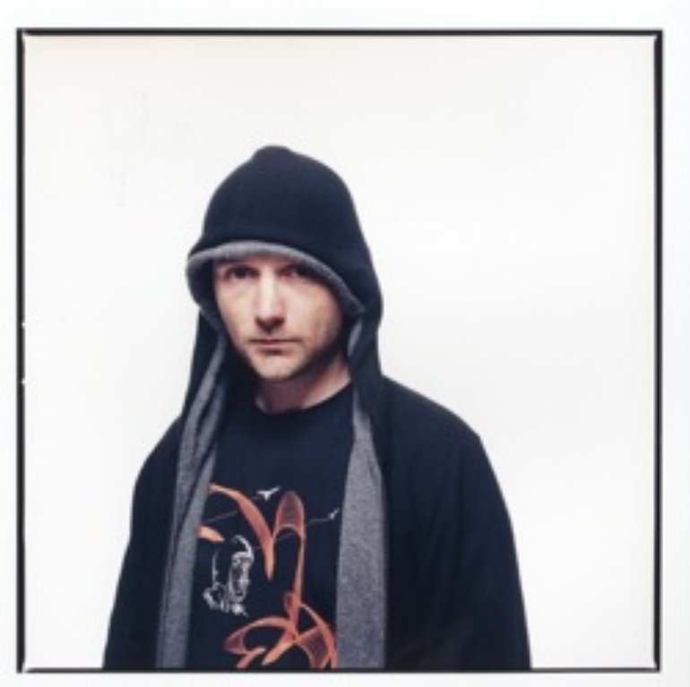 Moby with hoodie.