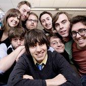The cast of CollegeHumor: Amir, Dan, Jake, Jeff, Patrick, Ricky, Sam, Sarah, and Streeter