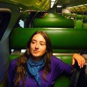 ayla on a green train
