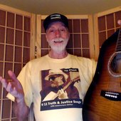 "Vic Sadot wearing his ""9/11Truth & Justice Songs\"" CD cover T-shirt"