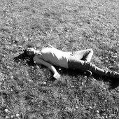 tooti laying somewhere. black and white