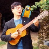 Gerald with Custard, the Macaw