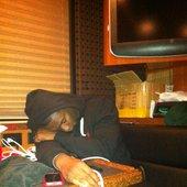 Juice McCain asleep on the tour bus #redalbumtour