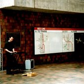 Playing keyboard in the Alewife train station 1994, where I developed most of my pieces for The Sound of Light CD. Photo by Michael Fischer