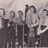 Dickie Jones (with fiddle) and band
