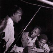Oscar Pettiford, Miles Davis, and Gil Coggins during the Miles Davis Volumes One and Two session, WOR Studios NYC, May 9 1952 (photo by Francis Wolff)