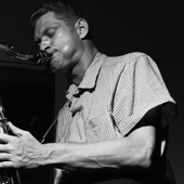 Zoot Sims plays the saxophone during the recording session for the Jutta Hipp with Zoot Sims album, 1956