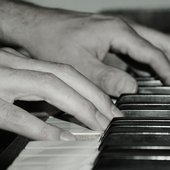 hands on piano....
