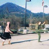 Nils and Dawm McCarthy dancing, or doing something