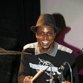 Mr Johnny Millebaga on stage