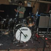 Dane setting up his drum kit in The Cellar