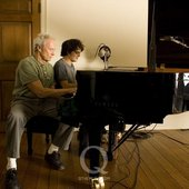 Clint and Cullum playing piano
