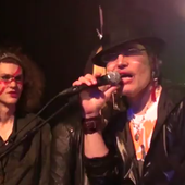 Peter Olive performing with Adam Ant