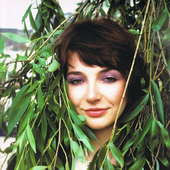 A smiling Kate Bush and plants
