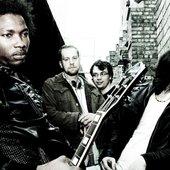 From front: Azeez (Vocals, Guiter) Neil (Guiter) Tom (Bass) Joe (Drums)