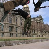 Goes Cube Jumping in Front of State Capitols