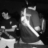 Greg jamming and Nick TP caught in a mosh.