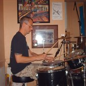 Playing drums.