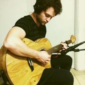 Christopher Von Uckermann playing guitar
