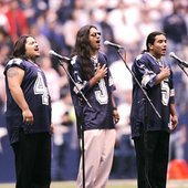 Los Lonely Boys singing at the Football