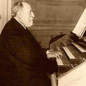 Camille_Saint-Saens_playing_at_his_organ