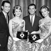 "1959: The Fleetwoods with Dick Clark, receiving their gold records for ""Come Softly to Me"" and ""Mr. Blue."""