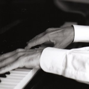 Image for 'Larre thanks Urs Ruchti playing Piano.'